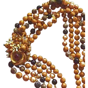 Five Strand Bead Necklace with Large Side Brooch Clasp in Brown Tones