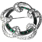 Scarce Boucher Pin Features Stunning Channel Set Emerald Green Stones