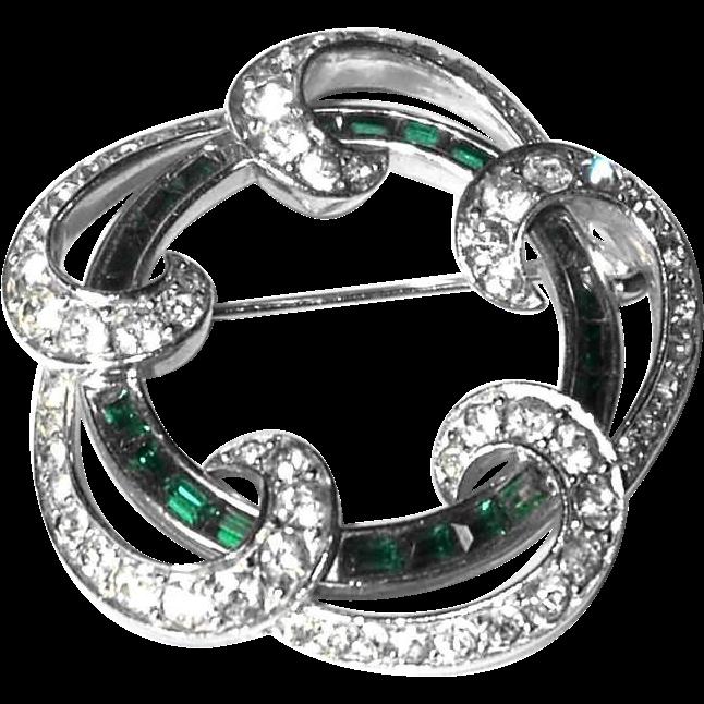 Scarce Boucher Pin Features Stunning Channel Set Emerald