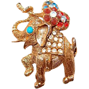 Rhinestone Adorned Elephant Pin Carrying Bunch of Flowers