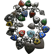 Vintage Five Enameled Pansies Twenty Eight Sterling Heart and Charm Bracelet