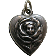 Antique Child's Face in Rose Sterling Heart Charm