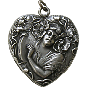 Unger Poppy Lady and Tambourine Sterling Heart Locket