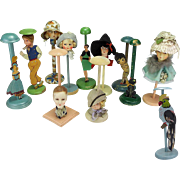 Twelve Art Deco Hat Stands