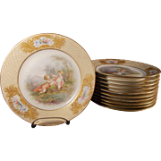 Pseudo Sevres Set of 11 Hand Painted Plates With Puti
