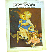 "1933 Christmas Issue of ""The Farmer's Wife"", Tot Holds Doll"