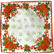 Red Poinsettia Bouquets Surround White Ones in Christmas Hanky