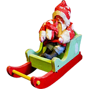 Vintage Clay-faced Santa in Red & Green Sled Arrives Bearing Gifts