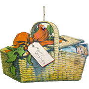 American made, Two sided, Die-cut, Lithographed Paper Basket with Baby Doll Xmas Ornament, 1915