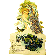 Victorian Pull-down Dimensional Die-cut Valentine, Cupid Plays a Violet Instrument