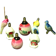 Seven C-6 Figural Milk Glass Christmas Lamps from the 1930s