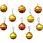 A Golden Cache of Vintage Shiny Brite Striped Mercury Glass Balls