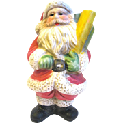 Small bisque Santa Claus Figurine Carries Packages