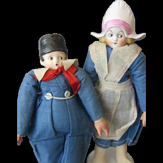 Googly Pair China Dolls - Dressed as Dutch Girl & Boy - Boy is a Smoker - Vintage