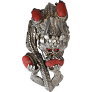 A Chinese sterling silver dragon bangle with four red coral bead