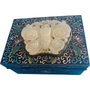 A Chinese cloisonné box with jade insert