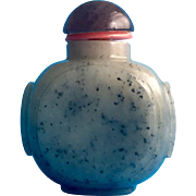 A Chinese celadon jade snuff bottle