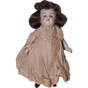 "All Bisque 4 1/2"" German Doll - Painted Eyes - orig. clothing"