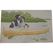 Edwardian Embossed Postcard Lovers in a Rowboat