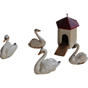 4 Cast Metal Miniature Swans and Wooden Pond House