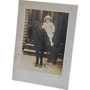 Early Photo of Child on Pony