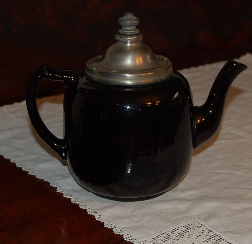 Unusual brown teapot with metal lid and infuser from