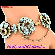 31815a - Hollycraft 1955 6 Swirling Sections Aqua Chaton & Baguette Stones Bracelet