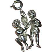 1960s Large Silvertone Cupid Nymphs with Flower Double-Sided Charm
