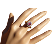 Neat Oval Ruby & Diamond Cluster Ring.