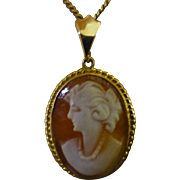 Real Natural Italian carved Cameo in mount & Gold chain.
