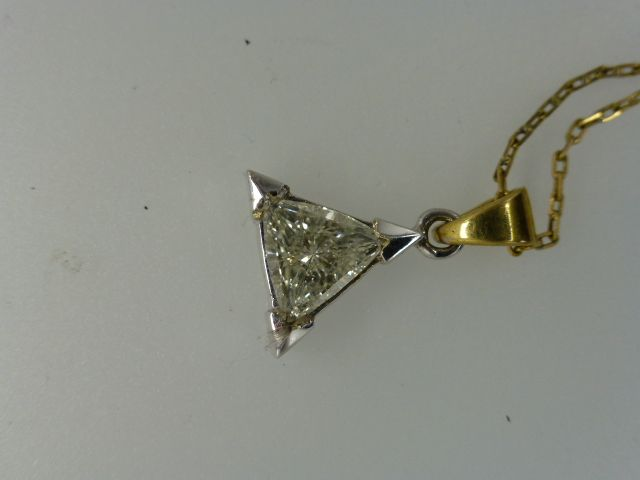 Triangular Natural  White Diamond with a 18k Pendent & Chain...
