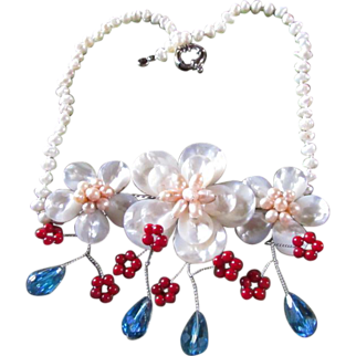 Elegant Mother of Pearl Floral Bib-Style Necklace With Lavish Embellishments Of Pinkish Pearls, Blue Crystals And Tiny Red Coral Beads That Combine To Make This A To-Die-For Piece ~