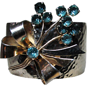 Upcycled Hammered 6KT Yellow Gold Fill Wide Cuff Bracelet Wearing A Gorgeous Blue-Green Tourmaline Crystal ISKEN Floral Bouquet (Brooch) On A 6 KT Yellow Gold Fill Over Sterling Silver Finding