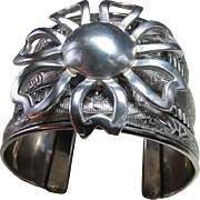 Upcycled NEPAL Silverplate Wide Cuff Animal Patterned Bracelet Bears A Stunning Abstract Sunburst (Or Flower) Of Sterling Silver