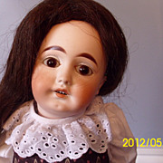 German bisque mystery doll with paperweight eyes