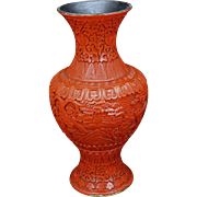Chinese carved red lacquer vase in garden with scholars late 19th century