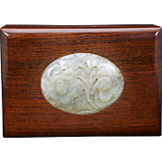 Antique Chinese pale green carved jade plaque mounted in rosewood box