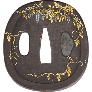 Japanese cast iron Tsuba with inlays of wisteria 19th century