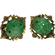 Vintage carved and pierced jade earrings in a stamped filigree screw mount