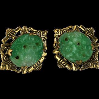 Vintage carved and pierced jade earrings in a stamped filigree screw mount