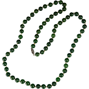 Vintage spinach green natural jade hand knotted necklace with old clasp circa 1930