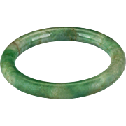 Chinese 51 mm mottled apple green and white jadeite toroid form bangle bracelet Qing dynasty 19th century