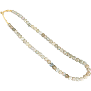 Necklace strand of Skunk eye or white-eye Italian made glass trade beads strung on raffia circa 18th-19th century