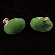Gilt metal screw back spinach jade earrings c 1940's