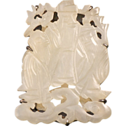 Chinese pale green jade carved and filigree plaque mounted in a sterling clothing clip frame