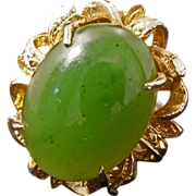 Vintage spinach green jade ring with silver-colored band and gold colored mount 20th century