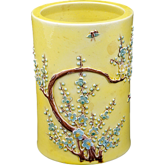 Yellow Chinese porcelain brush pot with applied prunus designs circa 1900