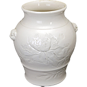 Chinese porcelain blanc de chine vase with foo lion handles and carved peony flower 19th century