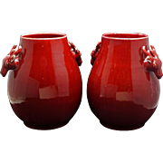 Pair of porcelain Chinese oxblood deer vases with Tongzhi/Guangxu reign marks