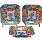 Set of three matched Japanese polychrome square Imari dishes 19th century